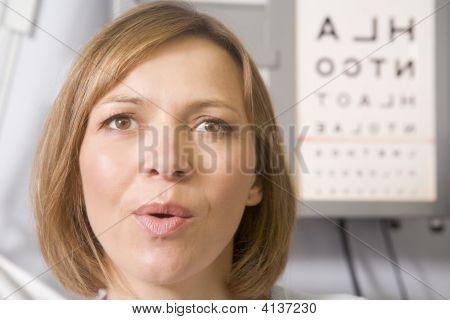 Woman In Optometrist'S Exam Room Taking Deep Breath