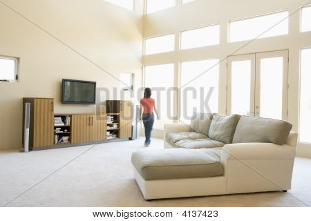 Woman Walking Through Living Room