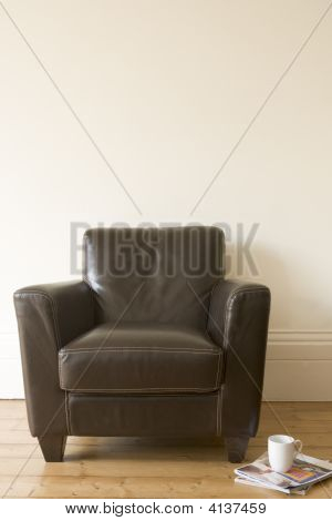 Chair With Coffee Mug And Magazine Beside It