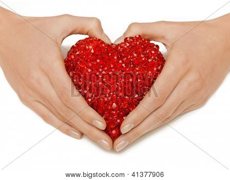 bright closeup picture of woman hands holding heart