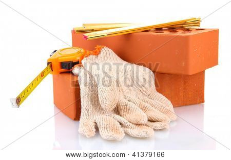 bricks, roulette and gloves isolated on white
