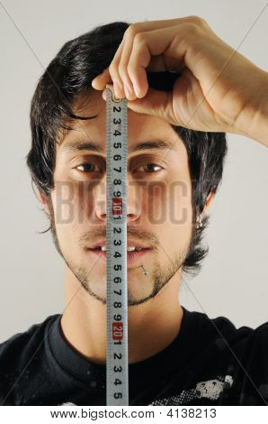 Man Measuring His Face