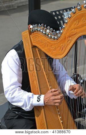 Playing celtic harp