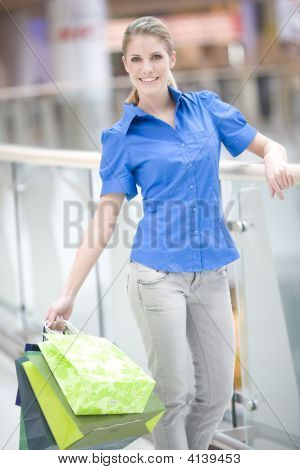 Young Woman In Shopping Centre