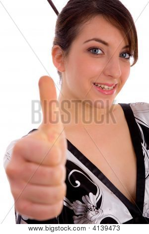 Front View Of Smiling Japanese Woman Showing Thumbs Up