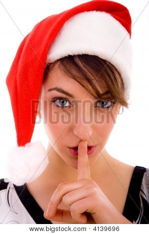 Front View Of Shushing Woman In Christmas Hat