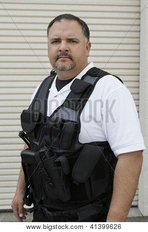 Portrait of a security guard wearing bulletproof jacket