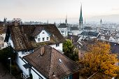 stock photo of zurich  - Aerial View on Tiled Roofs and Churches of Zurich at Fall Switzerland - JPG