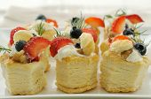 image of french pastry  - Fruit vol au vent stuffed with whipped cream and topped with strawberry slices and blueberry - JPG