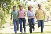 pic of portrait middle-aged man  - Two Couples running in a park - JPG