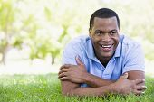 Man Lying Outdoors Smiling