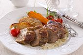 stock photo of barbary duck  - roasted goose breast fillet with quince and vegetable - JPG