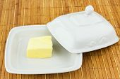 stock photo of yellow milk cap  - oval dish with the oil cap on a bamboo napkin - JPG