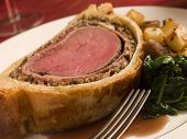 stock photo of beef wellington  - Dressed Side of Salmon Boxing Day Buffet - JPG