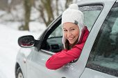 stock photo of slippery-roads  - Woman driving in winter on snow covered slippery road in forest - JPG