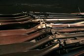 image of rifle  - Display of vintage, civil war era rifles