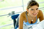 picture of derriere  - woman at the gym doing exercises on a machine for her bottom - JPG