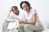 Worried African American couple over domestic bills poster