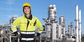 stock photo of retarded  - Proud and confident chemical engineer smiling into the camera in front of a petrochemical plabnt - JPG