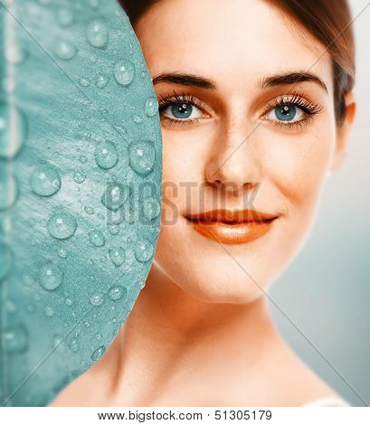 Beautiful young girl portrait close up. Skin care.