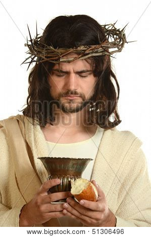 Portrait of Jesus holding a cup and bread isolated on a white background