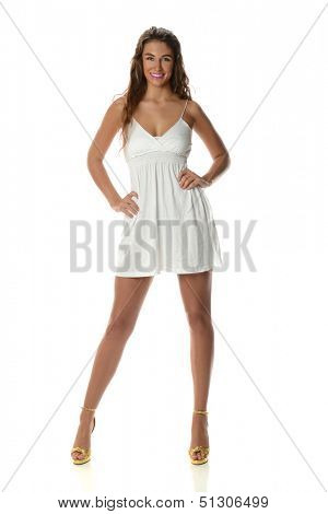 Young Woman with light short dress isolated on a white background