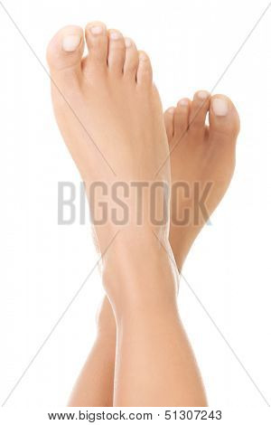 Beautiful caucasian woman feet. Isolated over white background