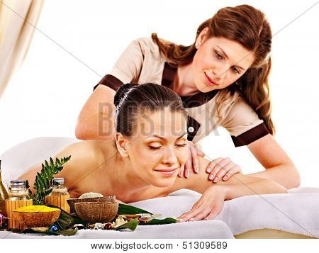 Young woman getting spa lastone therapy outdoor. Isolated.