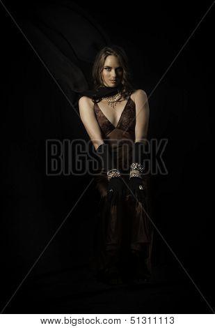 Beautiful brunette wearing vintage evening wear