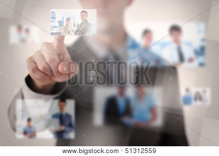 Businessman selecting a picture on blurred background