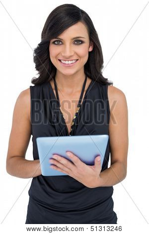 Smiling elegant brown haired model using tablet-computer on white background