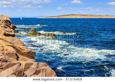 Seascape With Waves Crashing The Shore And Island