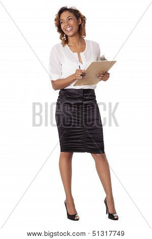 Woman Laughs And Smiles With Clipboard.