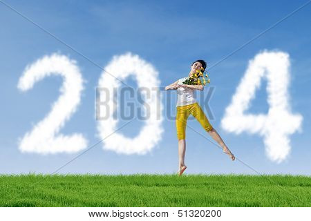 Dancer Woman With 2014 New Year Clouds