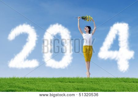 Woman Standing With 2014 New Year Clouds