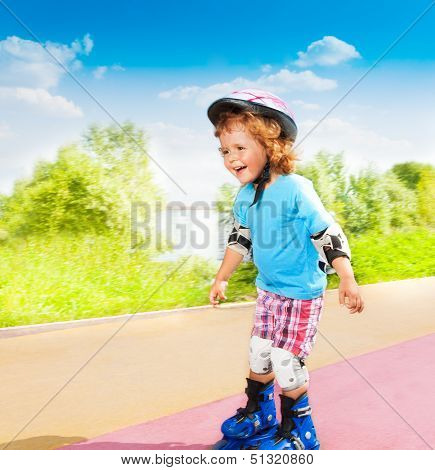Happy Little Boy Skating Downhill