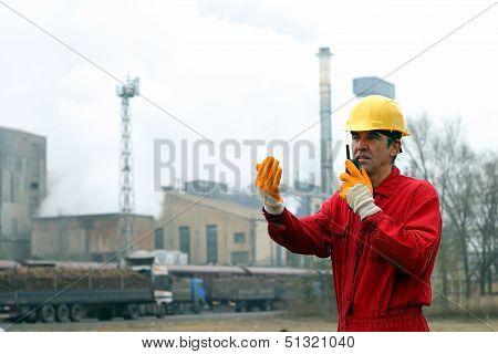 Industrial Worker Talking On Walkie-talkie