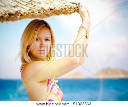 Young Pretty Woman On A Beach