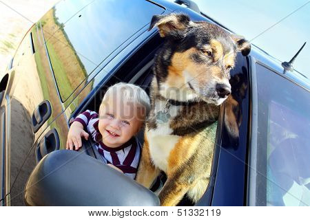Happy Baby And Dog In Minivan Window