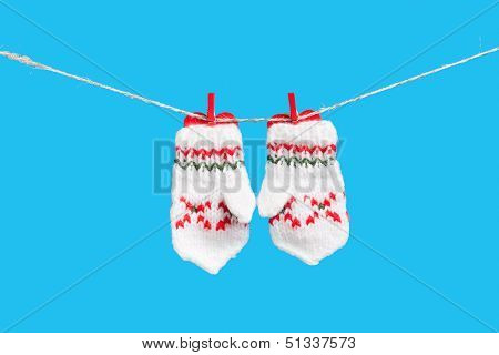 Two Mittens Isolated On Blue Background