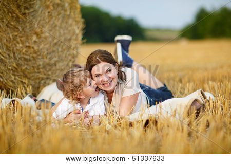 Young Mother And Her Little Son Having Fun At Picnicking