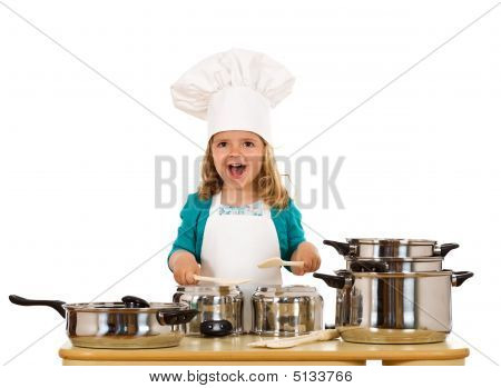 Happy Little Girl With Chef Hat Making Noise With The Cooking Pots