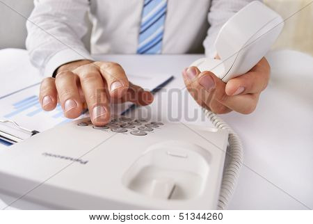 Man Making A Telephone Call On A Landline