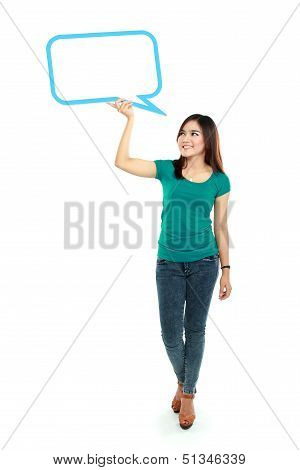 Portrait Of Full Lenght Young Girl Holding Blank Text Bubble In Specs