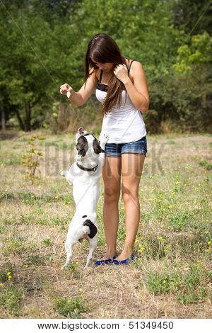 Teen Girl Playing With Her Puppy