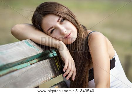 Portrait Of Pretty Teen Girl On A Bench