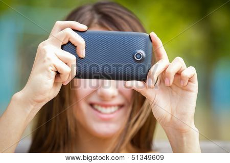 Happy Girl Taking Photo With Camera Phone