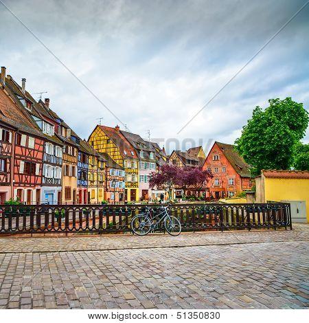 Colmar, Petit Venice, Bridge, Bike And Traditional Houses. Alsace, France.