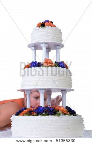 Final Retouching Ruffled Wedding Cake