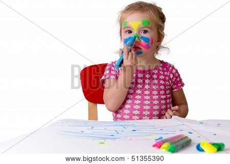 Toddler Girl Coloring Her Own Face